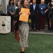 Associate Degree student Diana Nguyen receiving award for Australian Wool Education Trust (AWET) at the 2015 graduate exhibition, The Old Melbourne Gaol.