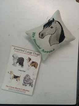 Sample from digital embroidery machine, and DVD of digital files of dog illustrations to program the machine.