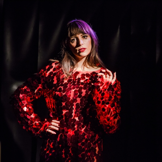 One of the WOWZZZEEE onesies gets modelled, photographed by Bryony Jackson.